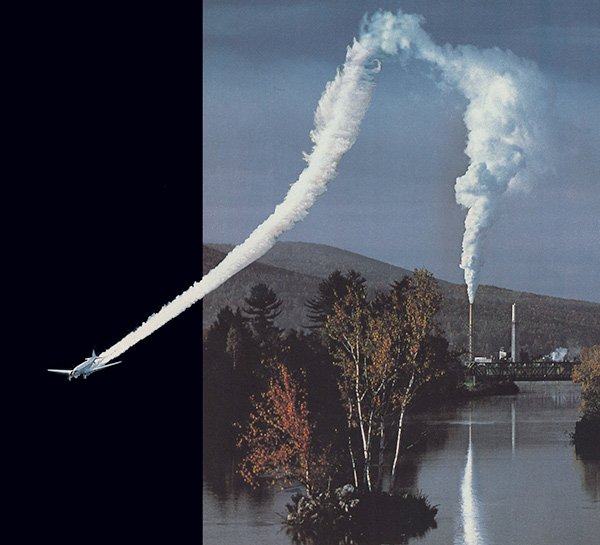 smoke coming out of factory that joins with the plume from a jet