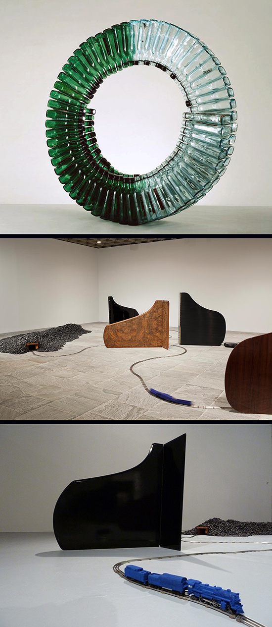 installation with bottles, pianos and model trains