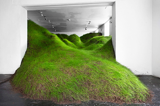 art installation of grass mounds