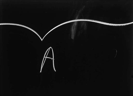 Erica Baum photo series of partially erased blackboards