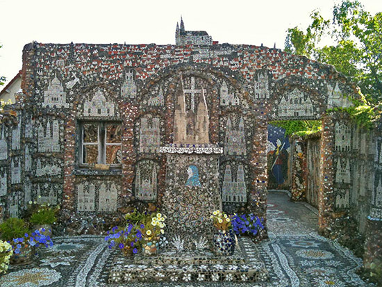 Raymond Isidore's mosaic covered home, courtyard with images of cathedrals
