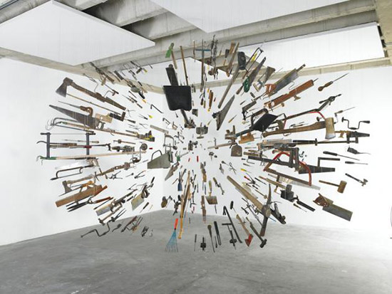 Sculptural art installation with hand tools, saws, cutting devices by Damian Ortega