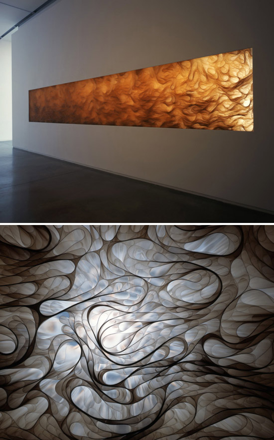 Installation set between exposed wall studs composed of sheets of polyester film by Tara Donovan