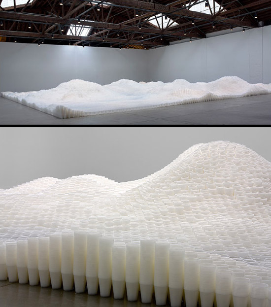 Undulating sculpture installation made with plastic drinking cups by Tara Donovan