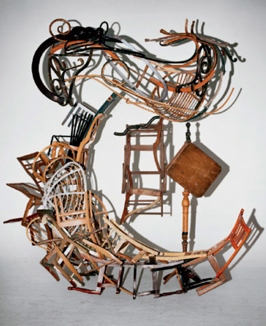 "the letter ""T"" created from chair parts by Marc Andre Robinson"