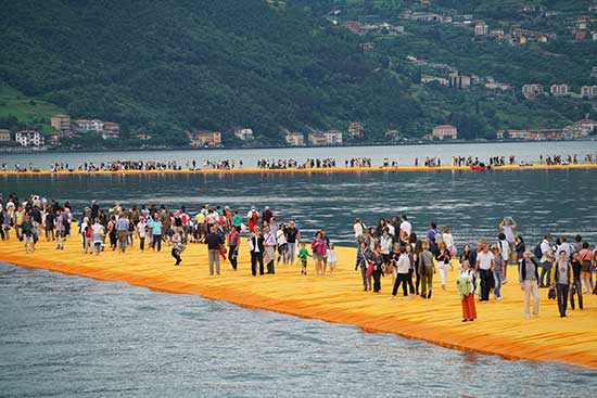 art installation, fabric covered floating piers by Christo and Jeanne-Claude