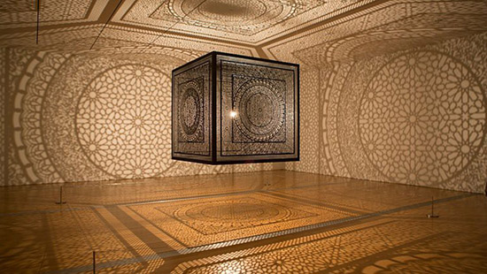 Art installation by Anila Quayyum Agha that uses laser cut wood and Islamic patterns