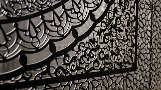 Art installation by Anila Quayyum Agha that uses laser cut wood and Islamic patterns, detail and a link to a video
