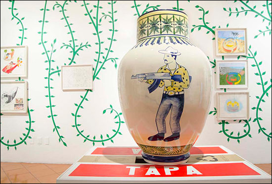 Eduardo Sarabia art installation with ceramic vase with hand painted narco culture image