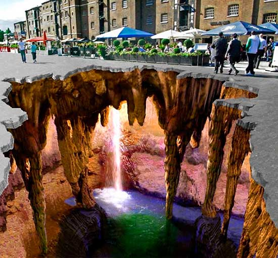 Trompe-l'oeil sidewalk chalk drawing of subterranean waterfall