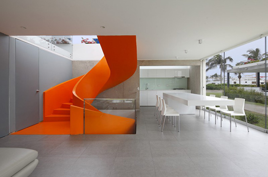 all white interior with bright orange stairway