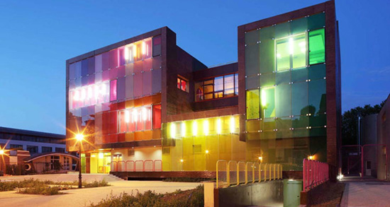 building exterior with color and lights