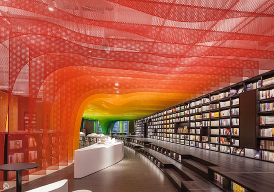 bookstore interior with rainbow colored metal detailing