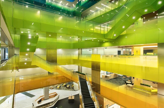architectural interior with green and yellow walkways and stairways