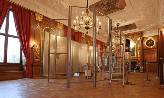 "glass partitions used with Mauritshuis scanning equipment used to scan ""Girl with a Pearl Earring"""