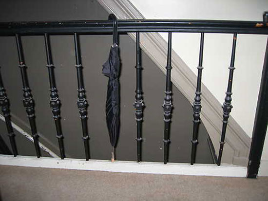 staircase baluster repaired with an umbrella